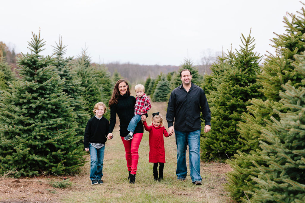 Family Picking real Christmas tree in Spring Field Kentucky